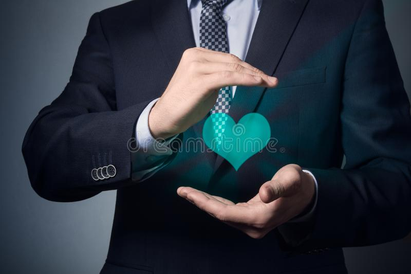 Life and health insurance. Businessman hands closeup. a man in business suit shows caring gesture. life and health insurance stock image