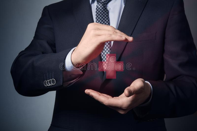 Life and health insurance. Businessman hands closeup. a man in business suit shows caring gesture. life and health insurance royalty free stock images