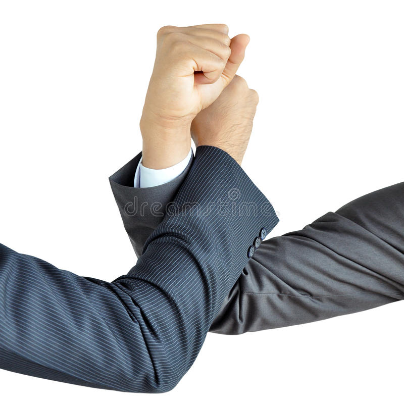Businessman hands engage in arm wrestling stock photography