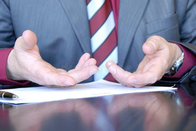 Businessman hands explaining. Businessman hands on desk gesticulation stock photo
