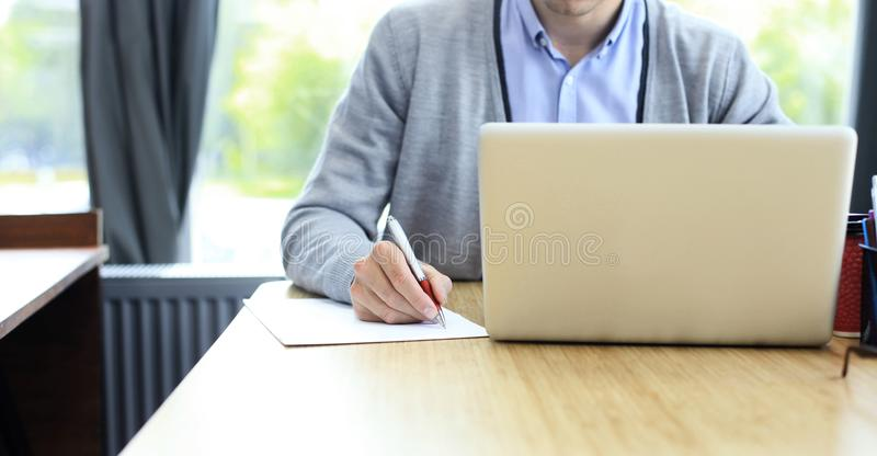 Businessman hands pointing at business document. Closeup. royalty free stock photography