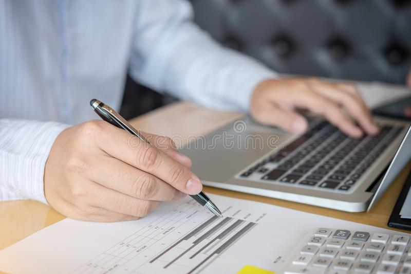 Businessman hands pointing at document and typing keyboard, during explanation of new plan project data at meeting royalty free stock photography