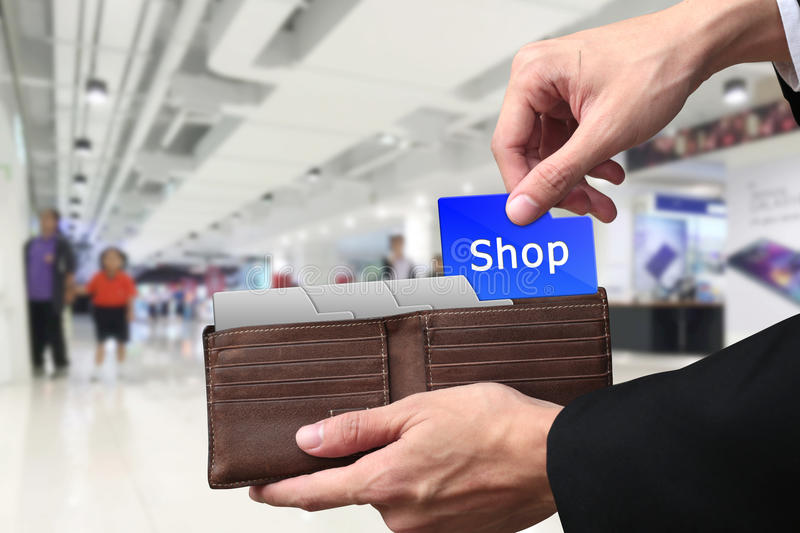 Businessman hands pulling money Shopping concept on brown wallet royalty free stock photography