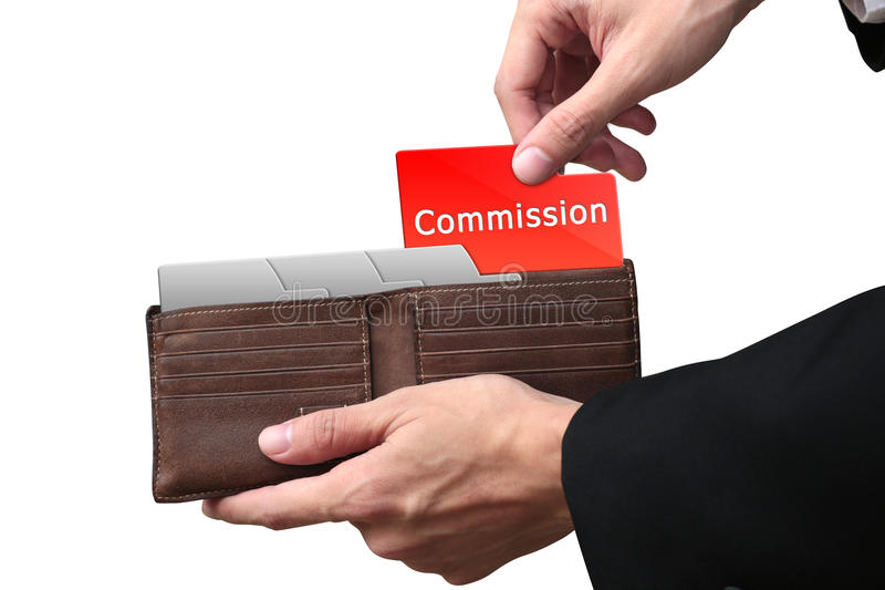 Businessman hands pulling red folder COMMISSION concept on brown stock photography