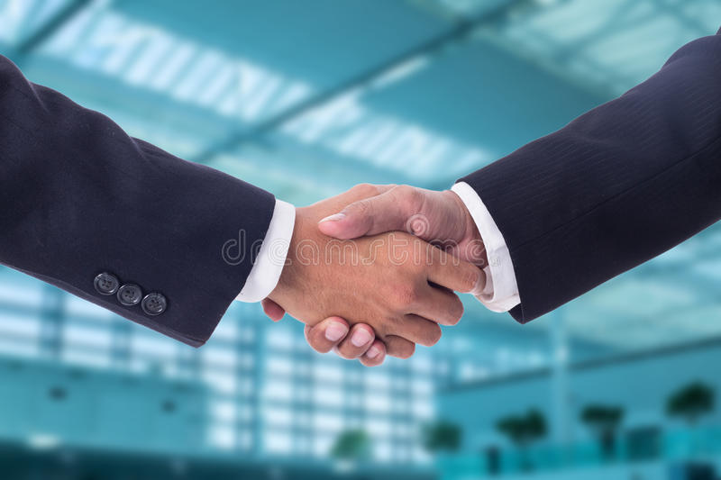 Businessman handshake for agreement. With partnership to agree their business stock photo