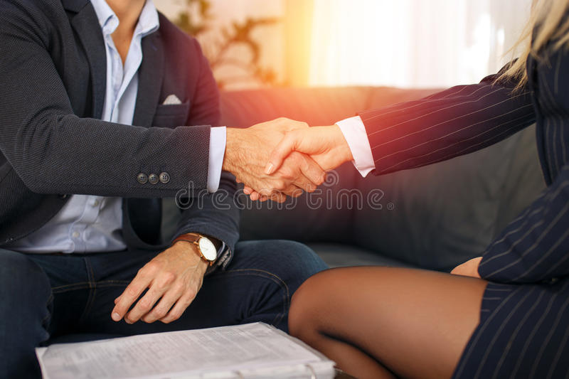 Businessman handshake with businesswoman in sunset royalty free stock images