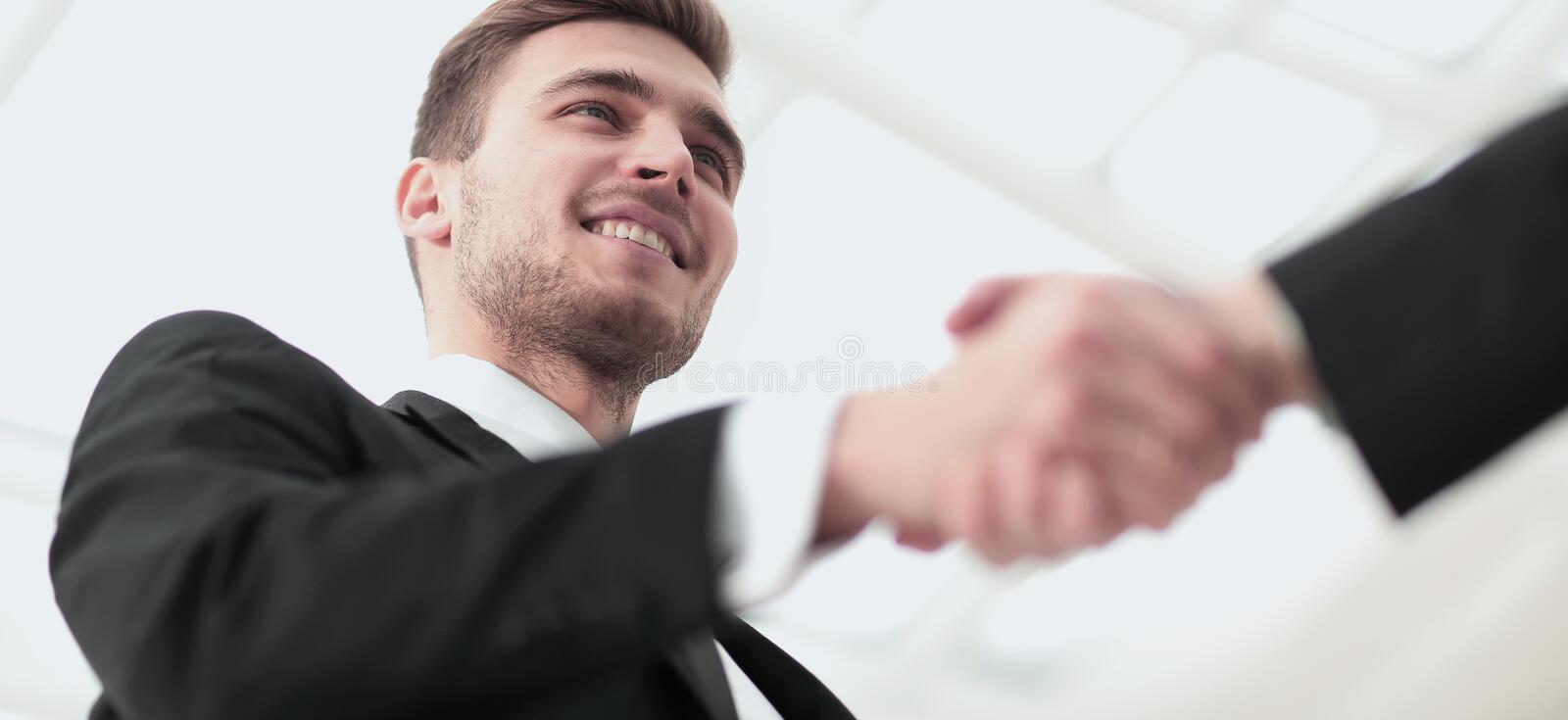 Closeup of handshake as a sign of successful cooperation and int stock photography