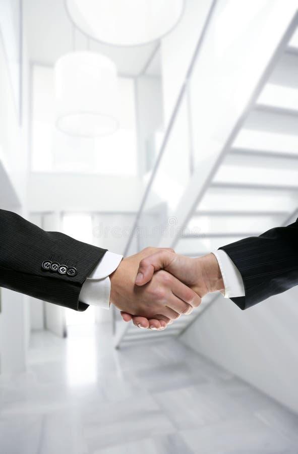 Download Businessman Handshake On Modern White Office Stock Photo - Image: 8822812
