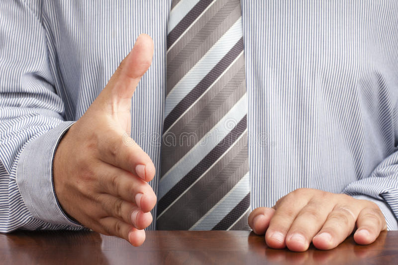 Businessman Handshaking Hand Deal Sitting Desk royalty free stock photo