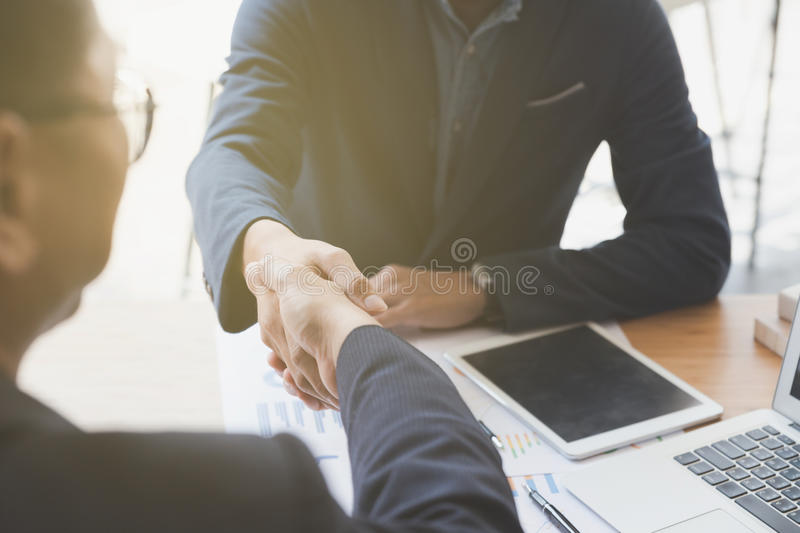 Businessman handshaking after meeting in office - teamwork, coop. Two businessman handshaking for successful deal after negotiation in meeting. business stock photography