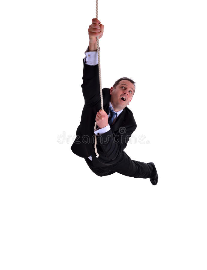 Businessman hanging on. Image of a businessman hanging on a rope. Isolated on white royalty free stock photos