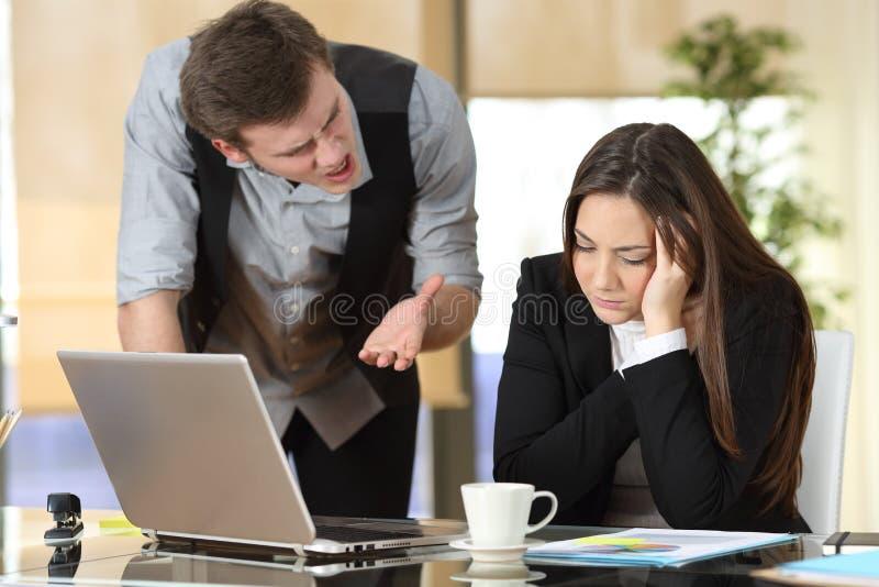 Businessman harassing at intern at office stock image
