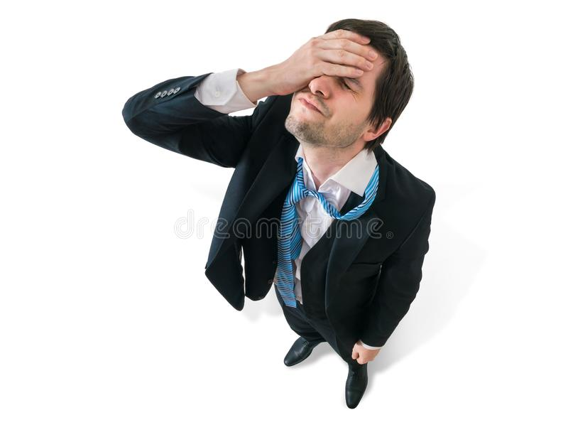 Businessman has headache. Disappointment and failure concept. Isolated on white background royalty free stock photography