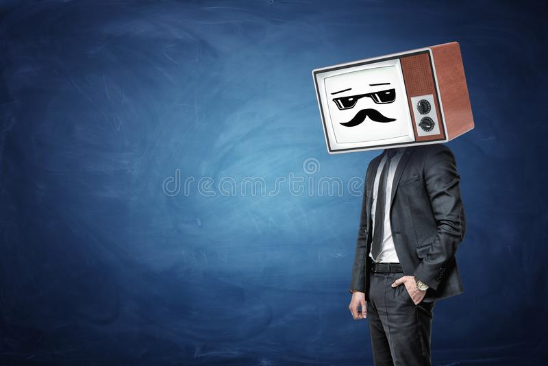 A businessman has one in a pocket and wears an old TV instead of his head, while it shows a white cool guy emoticon. Feel like boss. Winning attitude. Expert royalty free stock images