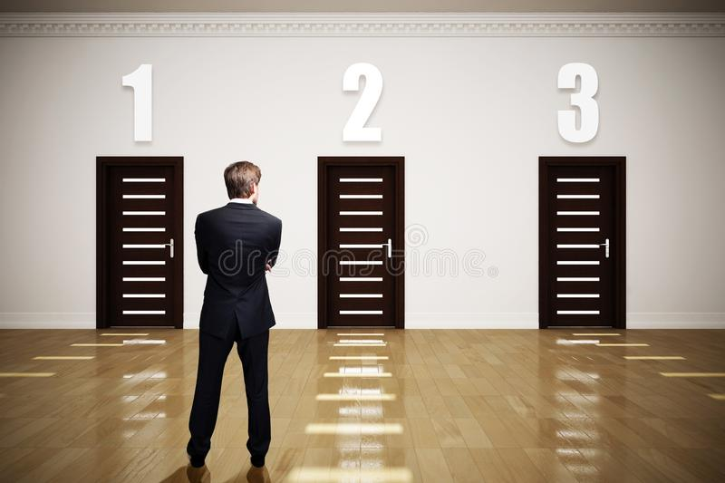 Businessman has to choose between 3 options royalty free stock photography