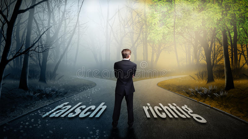 Businessman has to decide which direction is better with the words `wrong` and `right` on the road royalty free stock photography