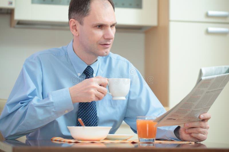 Businessman having breakfast stock photography