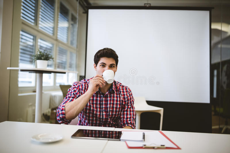 Businessman having coffee in meeting room stock photography