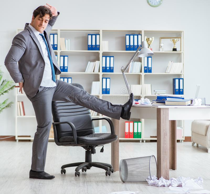 Businessman having fun taking a break in the office at work stock images