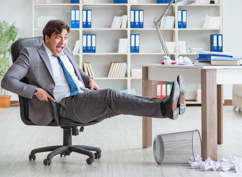 Businessman having fun taking a break in the office at work stock photo