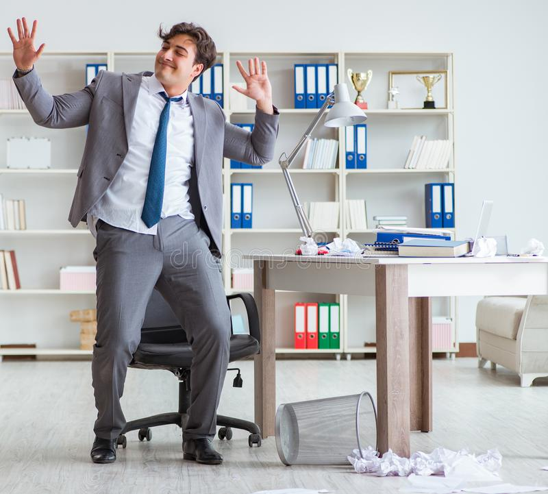 Businessman having fun taking a break in the office at work stock photos