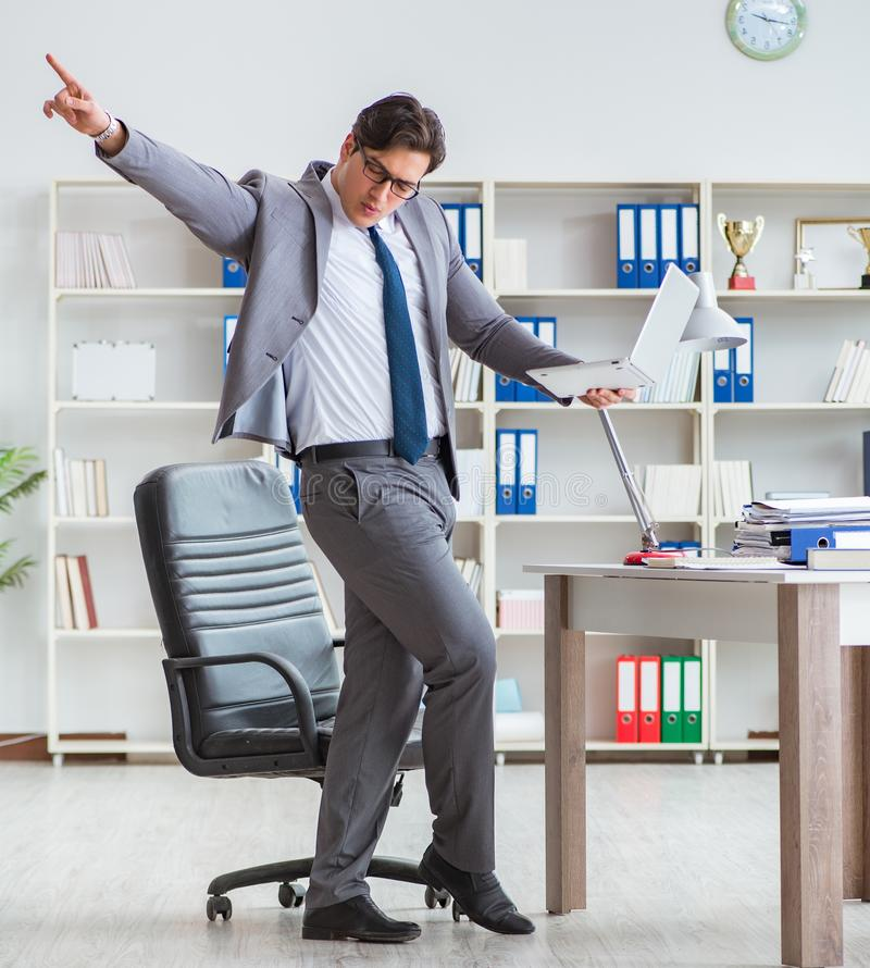 Businessman having fun taking a break in the office at work. The businessman having fun taking a break in the office at work stock image