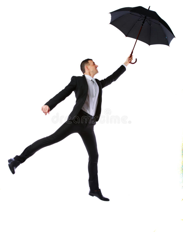 Businessman having fun with umbrella. Isolated on a white background royalty free stock images