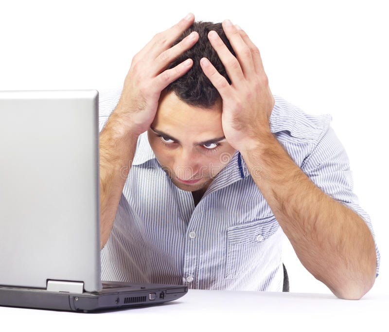 Businessman having headache at work royalty free stock photo