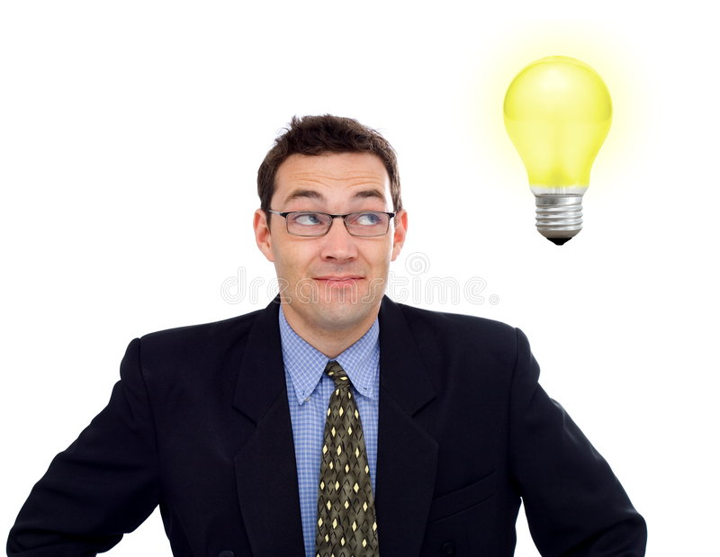 Businessman having an idea. Happy businessman having a bright idea (represented by a yellow bulb stock photos