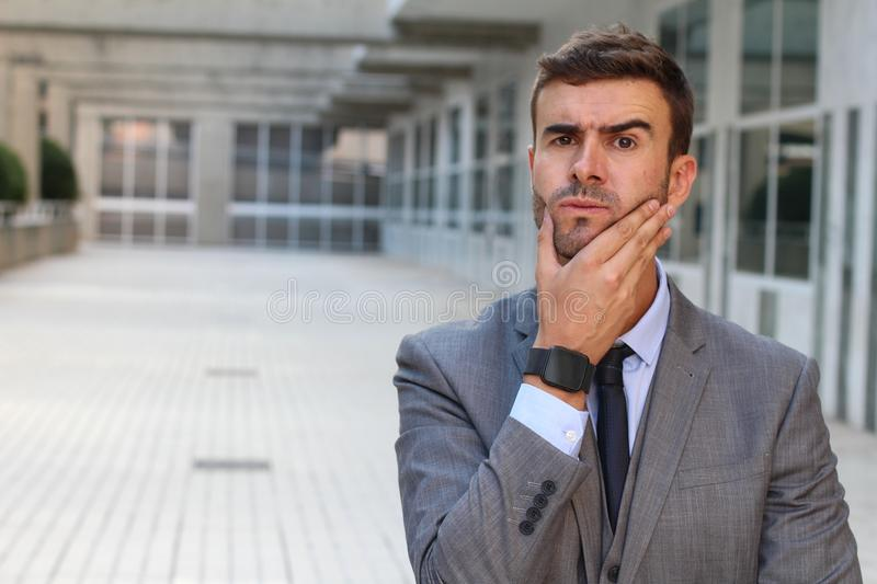 Businessman having a major dilemma stock photos
