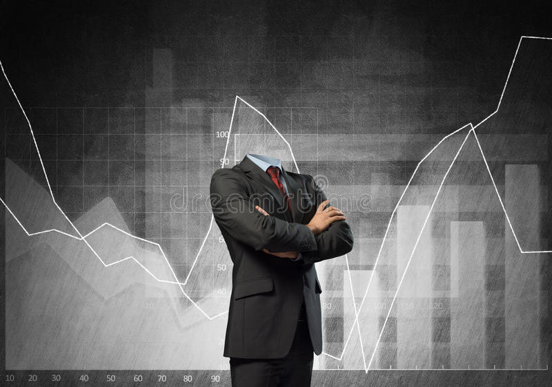 Businessman without head. Headless businessman with arms crossed on chest in black suit stock images