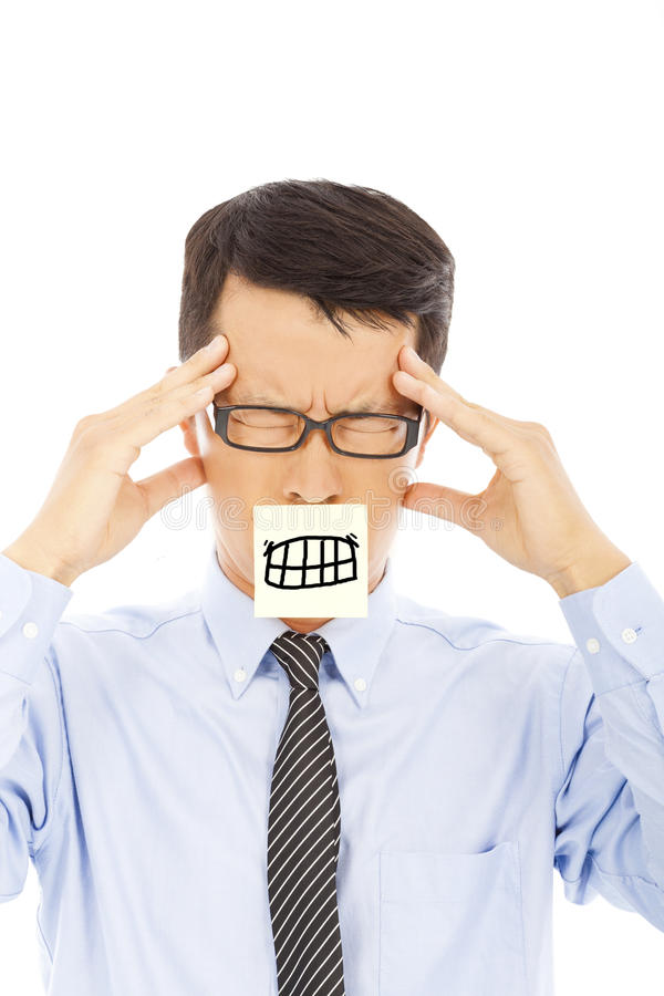 Businessman with headache and angry expression on sticker. In studio stock image
