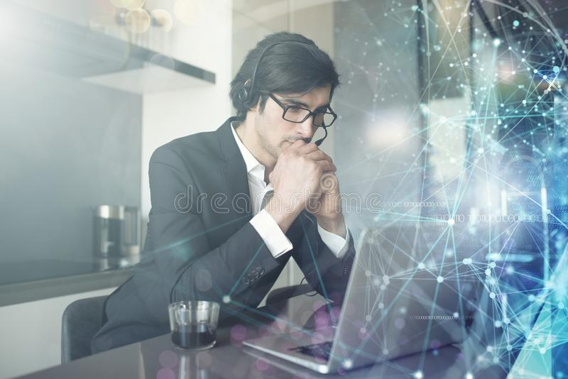Businessman works from remote at home with his colleagues stock photography