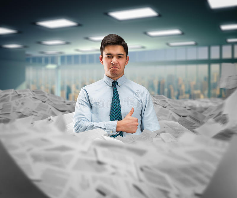 Businessman in the heap of papers royalty free stock photos