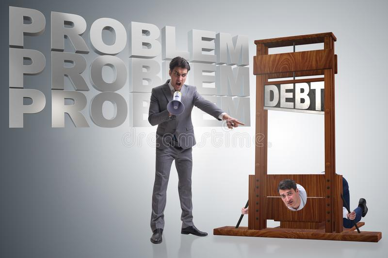 The businessman in heavy debt business concept stock photo