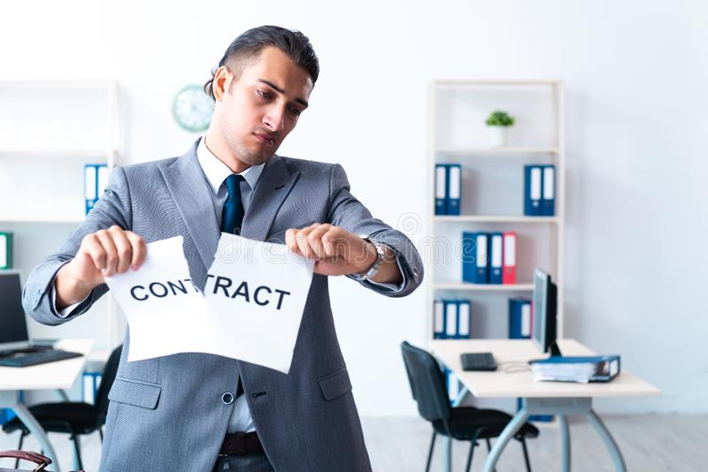 Businessman with heavy paperwork workload. The businessman with heavy paperwork workload royalty free stock photos