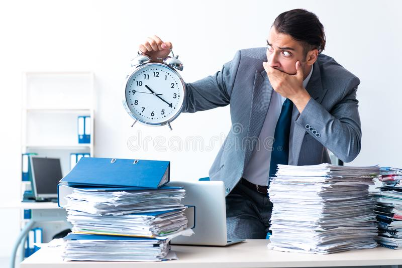 Businessman with heavy paperwork workload royalty free stock photos