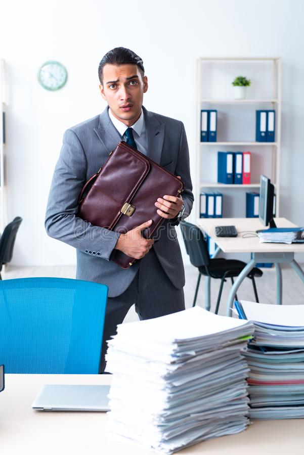 Businessman with heavy paperwork workload stock photos