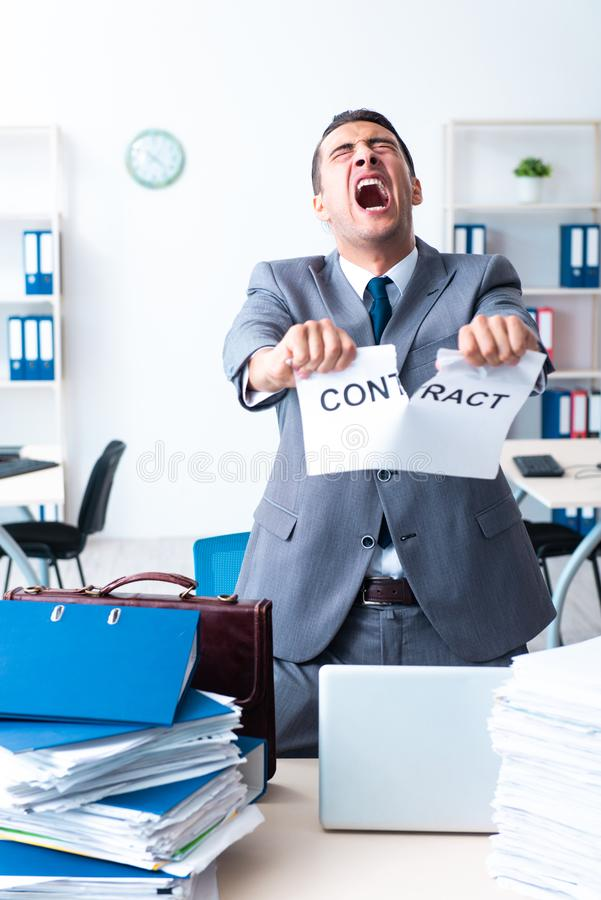 Businessman with heavy paperwork workload stock image