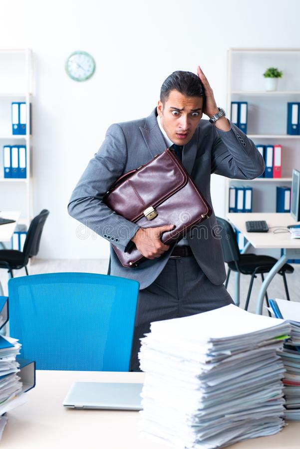 Businessman with heavy paperwork workload royalty free stock image