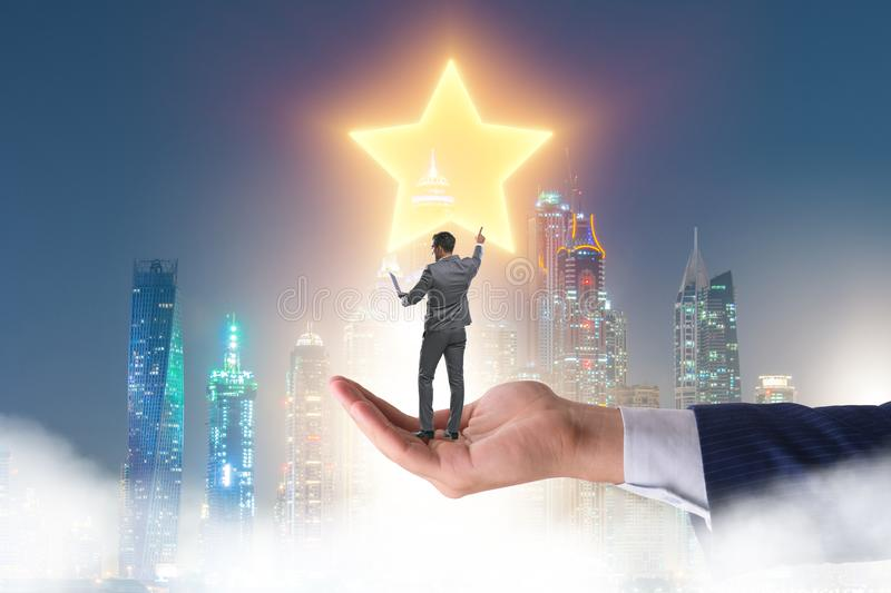 Businessman held on hand reaching out for stars. The businessman held on hand reaching out for stars royalty free stock image