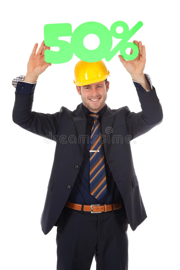 Businessman with helmet, discount. Attractive young caucasian businessman with helmet showing fifty percent discount sign overhead. Studio shot. White background stock photo
