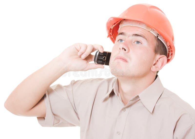 Businessman In Helmet On The Phone Stock Photo