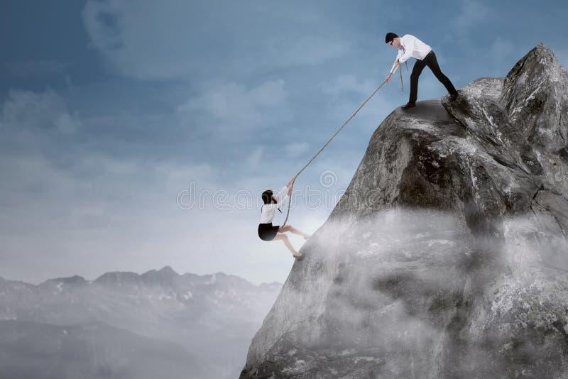Download Businessman Help His Partner Stock Photo - Image: 38668188