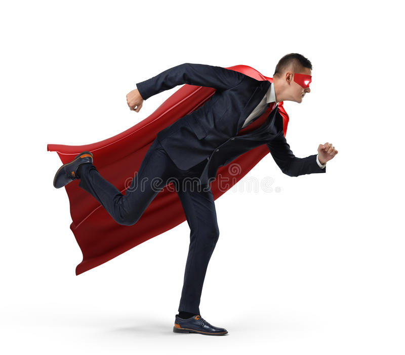 A businessman in a hero red cape and a mask in side view ready to run with one leg already in air on white background. Business and competition. Getting stock photo