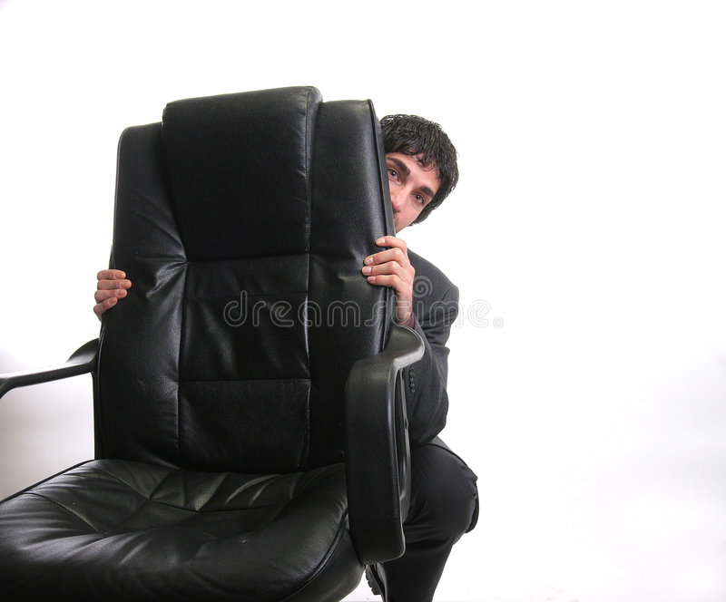 Businessman hiding stock photography