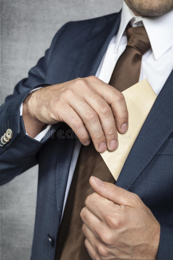 Businessman hiding bribes royalty free stock photography