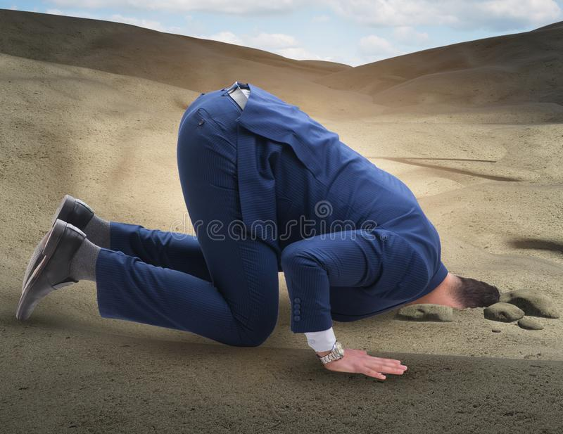 Businessman hiding his head in sand escaping from problems royalty free stock photography