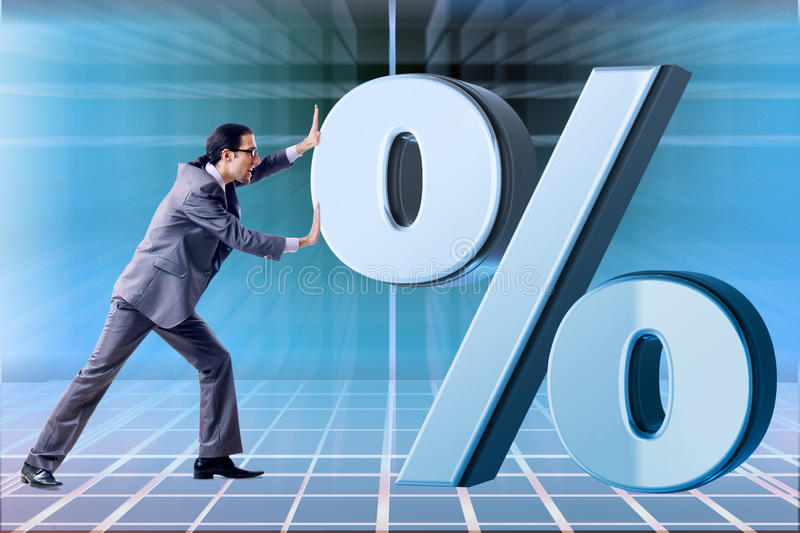 The businessman in high interest rates concept. Businessman in high interest rates concept royalty free stock image