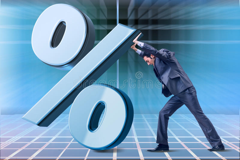 The businessman in high interest rates concept. Businessman in high interest rates concept stock photos